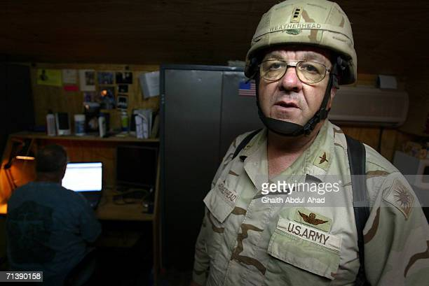 Army pilot CW3 Randy Weatherhead veterans of the Vietnam war poses for a photo in full combat gear in his room on June 12 2005 in FOB Speicher Iraq