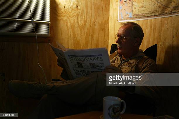 Army pilot CW5 DeWayne Browning a veteran of the Vietnam war reads a newspaper in his room on June 12 2005 in FOB Speicher Iraq