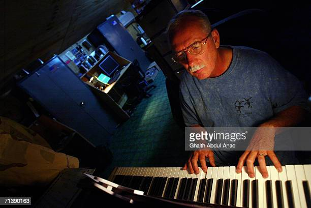 Army pilots CW5 DeWayne Browning a veteran of the Vietnam war plays music in his room on June 12 2005 in FOB Speicher Iraq