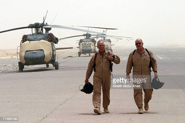 Army pilots CW5 DeWayne Browning and CW3 Randy Weatherhead veterans of the Vietnam war walk to their plane on the base airfield on June 12 2005 in...