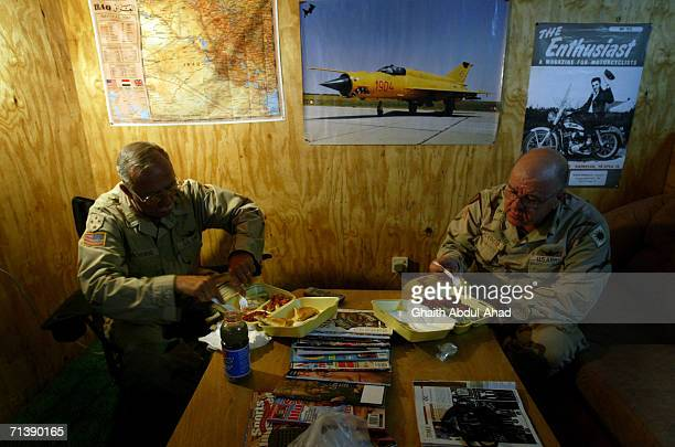 Army pilots CW5 DeWayne Browning and CW3 Randy Weatherhead veterans of the Vietnam war have dinner in there room on June 12 2005 in FOB Speicher Iraq