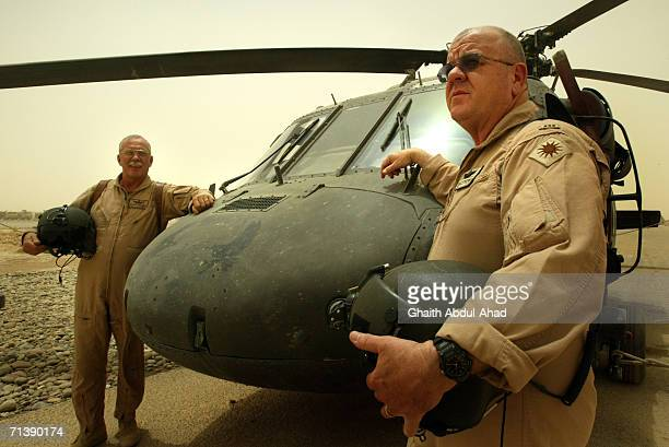 Army pilots CW5 DeWayne Browning and CW3 Randy Weatherhead veterans of the Vietnam war stand next to their Black Hawk helicopter in the airfield on...