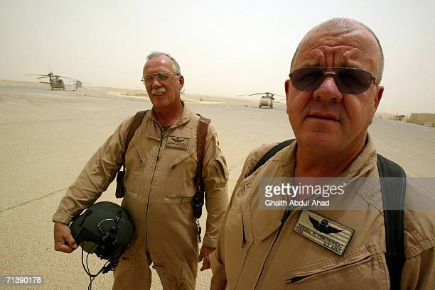 Army pilots CW5 DeWayne Browning and CW3 Randy Weatherhead veterans of the Vietnam war pose for photographys in the base airfield on June 12 2005 in...