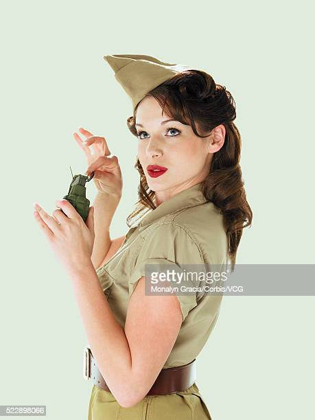 army pinup holding grenade - 40s pin up girls stock photos and pictures