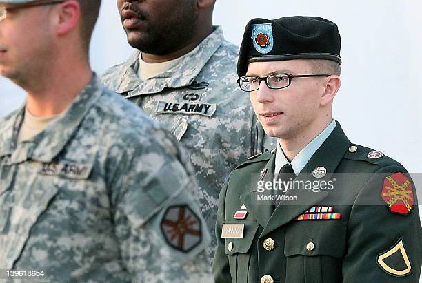 Army Private Bradley Manning is escorted away from his Article 32 hearing February 23 2012 in Fort Meade Maryland During the hearing Manning deferred...