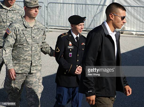 S Army Private Bradley Manning is escorted during his arrival to military court on the first day of a threeday motion hearing June 6 2012 in Fort...
