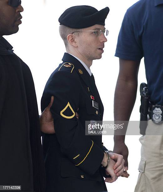 US Army Private First Class Bradley Manning arrives alongside military officials at a US military court facility to hear his sentence in his trial at...