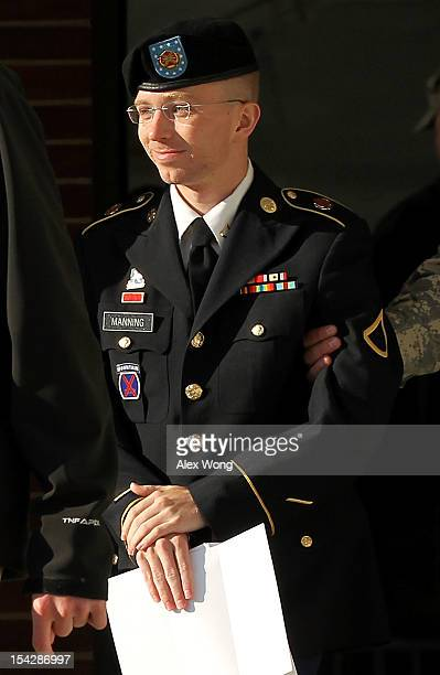 S Army private first class Bradley Manning is escorted away after a hearing on the witness list of a speedy trial motion October 17 2012 at Fort...