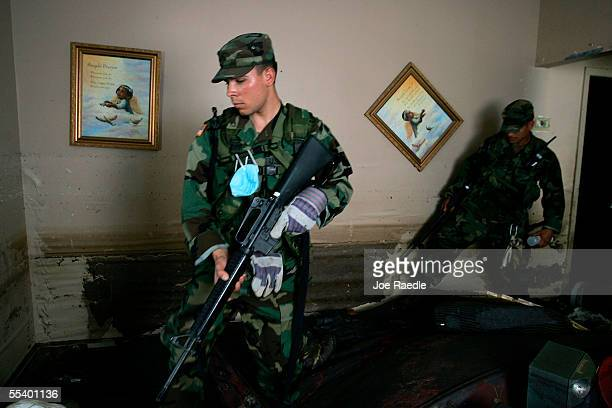 S Army Private Nick Snegirer from Salem Oregon and Sergeant Dahir Jacobo from Salem Oregon of the Oregon National Guard check an open home for bodies...