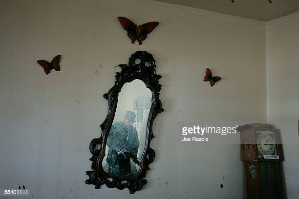 S Army Private Shawn Taylro from Salem Oregon of the Oregon National Guard is reflected in a mirror as he checks an open home for bodies or people...
