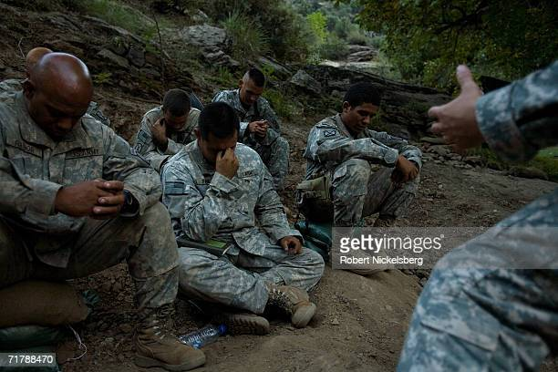 A US Army Protestant Chaplain assigned to the 10th Mountain Division right offers an interdenominational Saturday service to soldiers headed on a...