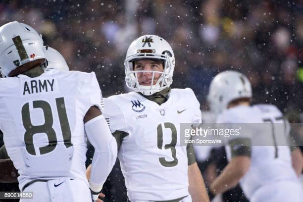 Army QB Luke Langdon looks at the replay board during a review in the second half during the game between The Army Black Knights and Navy Midshipmen...