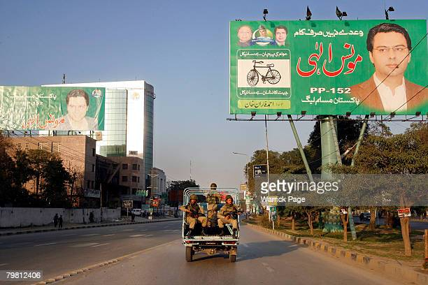 Army Rangers drive past election banners on the eve of national elections February 17 2008 in Lahore Pakistan Pakistani national elections will take...