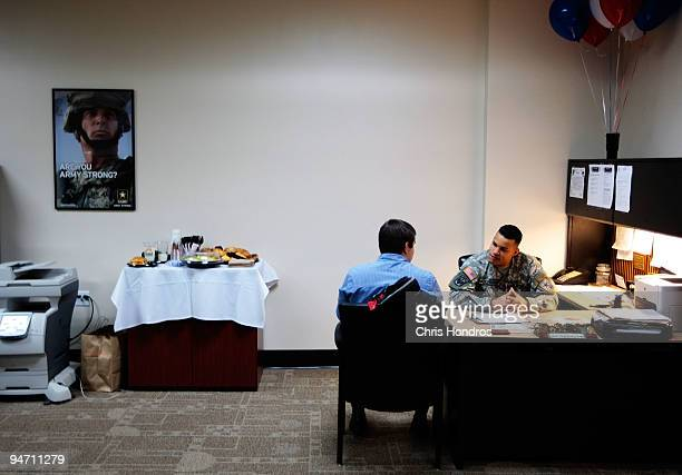 Army recruiter Staff Sgt Pablo Valdez Martinez chats with a potential Army recruit in the new office for the City Hall Recruiting Station December 17...