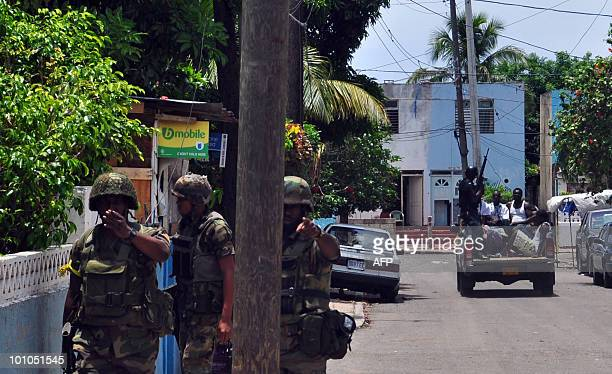 Army reinforcements arrive at the troubled Tivoli Gardens locality of Kingston Jamaica where security forces are waging a housetohouse search for a...