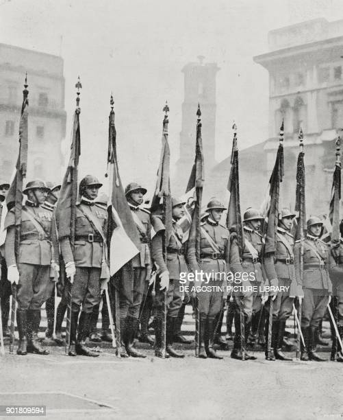 Army representatives with flags in Piazza del Duomo in Milan Italy 6th anniversary of national victory in World War I from L'Illustrazione Italiana...
