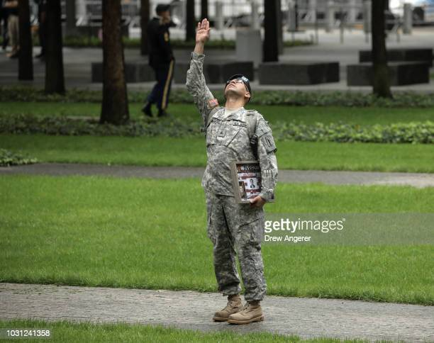 Army Reserve Sgt Edwin Morales waves skyward in memory of his late friend Ruben Correa a firefighter who died in the 9/11 attacks before the start of...