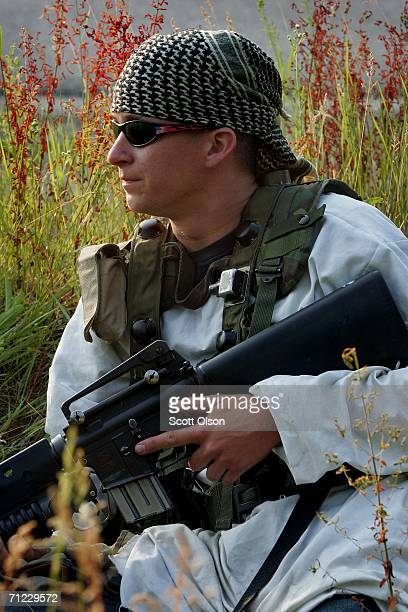 S Army reserve Spec Jeremiah Braun of St Peter Minnesota serving with 367 Bravo Company out of Mankato Minnesota prepares to attack a convoy while...