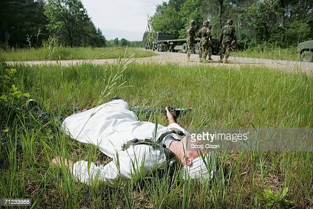 S Army reserve Specialist Albert Kuehne of Watertown Minnesota serving with 452nd out of Winthrop Minnesota pretends to be an insurgent casualty...