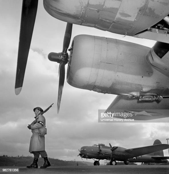 Army Sentry Guarding new B17F Bombers at Airfield of Boeing Plant Seattle Washington USA Andreas Feininger for Office of War Information December 1942