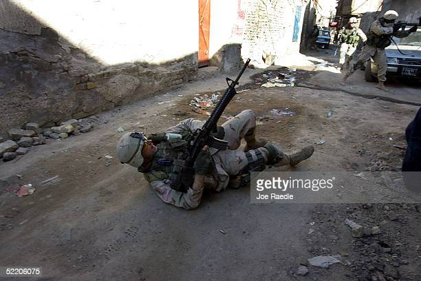 Army Sergeant 1st Class Troy Hawkins of the 1st Cavalry, Task Force 1-9, falls to the ground after being wounded during a firefight while on patrol...