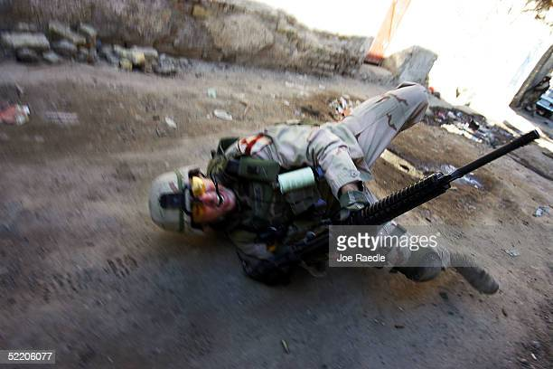 US Army Sergeant 1st Class Troy Hawkins of the 1st Cavalry Task Force 19 falls to the ground after being wounded during a firefight while on patrol...