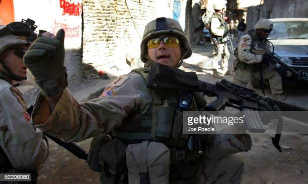 Army Sergeant 1st Class Troy Hawkins of the 1st Cavalry, Task Force 1-9, yells for Iraqi soldiers to push forward just before getting wounded during...