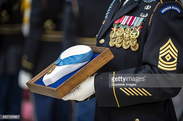 u.s. army sergeant holds the medal of honor. - us military emblems stock pictures, royalty-free photos & images