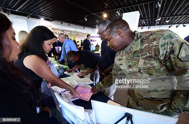 US Army Sergeant Kierre Tate inquires about employment prospects at the first Los Angeles International Airport Job Fair for Veterans in Los Angeles...
