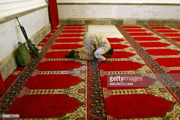 US Army sergeant Mesahchai Whitaker from the 4th Infantry Division performs the Friday noon prayers in alHara alGabir mosque at the palace compound...