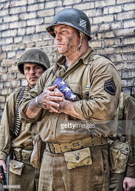 WWII US Army Sergeant Solemnly Holding Folded Flag