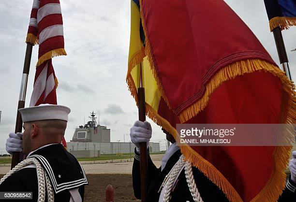 US Army servicemen carry flags during the inauguration ceremony of the Aegis Ashore Romania facility at the Deveselu military base on May 12 2016 The...
