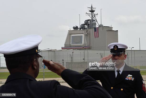 US Army servicemen salute during the inauguration ceremony of the Aegis Ashore Romania facility at the Deveselu military base on May 12 2016 The...