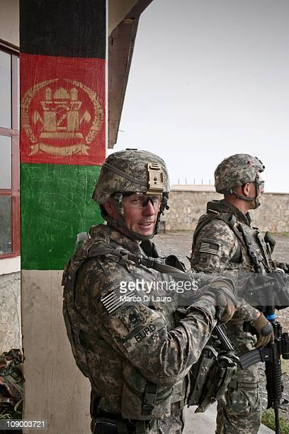 Army SFC Timothy Burd from Georgia Alpha Company 1/121 Infantry 48th BCT secure a school during a mission of the US Army Embedded Training Team and...