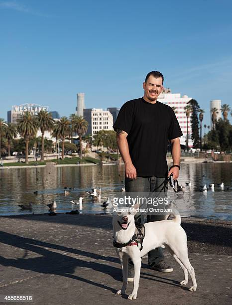 Army Sgt Adam Renteria and dog Rakkasan are photographed for People Magazine on March 19 2014 in Los Angeles California Diagnosed with a traumatic...