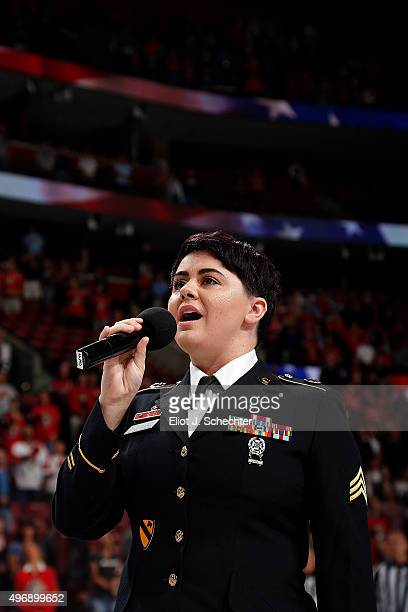 S Army Sgt Corrin Campbell sings the national anthem prior to the start of the game between the Florida Panthers and the Calgary Flames at the BBT...