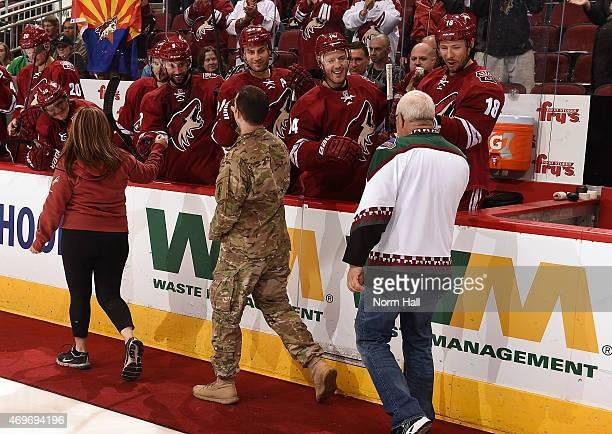 Army Sgt Daniel Urman and his parents Eitan and Ronit are congratulated by Sam Gagner Kyle Chipchura Joe Vitale and David Moss and teammates of the...