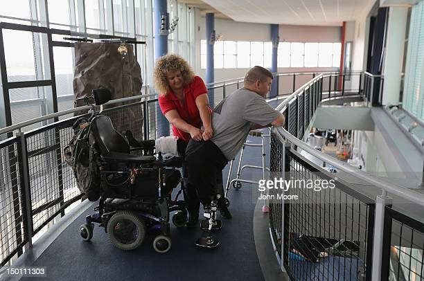 S Army Sgt Ed Matayka 34 and a double amputee works with physical therapist Melisa Howard at the Center for the Intrepid rehabilitation gym at Brooke...