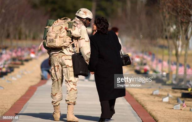 Army Sgt. First Class Johnny Gibson kisses his wife Erika Gibson after a welcome home ceremony for 330 soldiers from the 3rd Infantry Division...