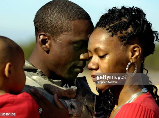 S Army Sgt Jatorrio Brooks holds his wife Stephanie Brooks and son TyReeq Brooks during a homecoming ceremony for 200 soldiers with the 4th Brigade...