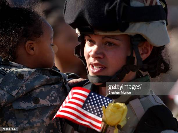 Army Sgt. Jennifer Brown holds her 1-year-old daughter Dacia after a welcome home ceremony for 330 soldiers from the 3rd Infantry Division January 7,...