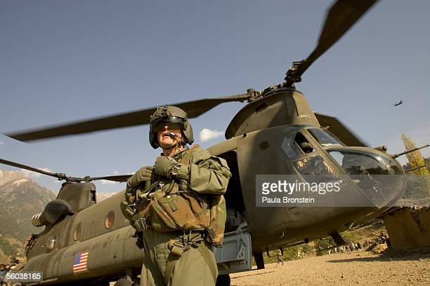 S Army Sgt Jonathan Clark with the 25th Infantry Division Bravo company 214 Aviation Regiment out of Hawaii stands near an Army Chinook helicopter...