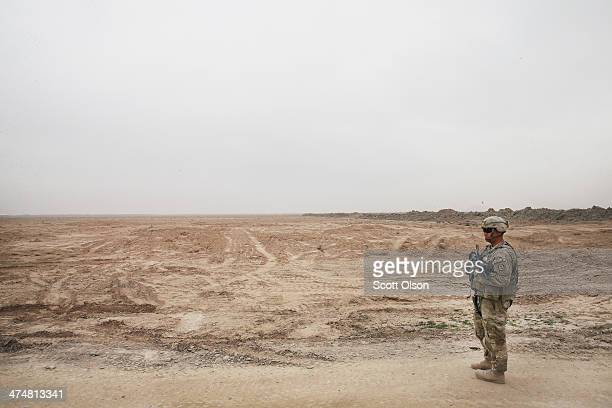 S Army SGT Matt Farkas from Sierra Vista Arizona with 4th squadron 2d Cavalry Regiment keeps watch as the unit visits an Afghan National Police...