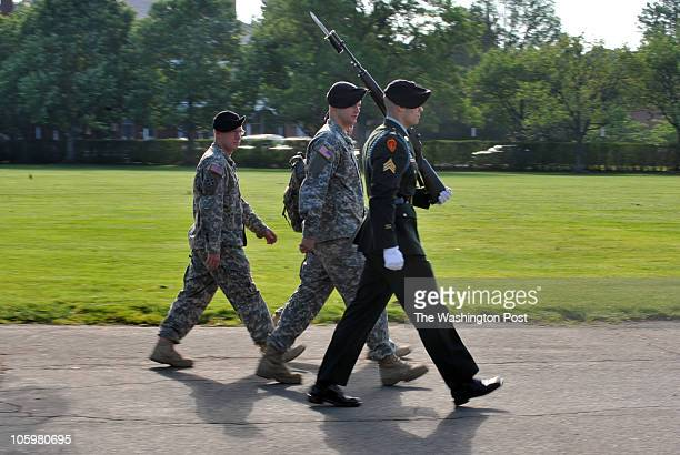 Army Sgt Nicholas Pata R goes through his marching test under the watchful eyes of Sgt Ian Golden L and tester Corp Dustin Bryant C as Pata goes...