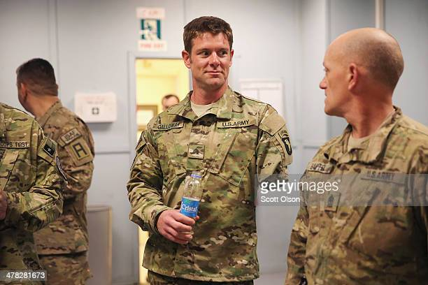 S Army SGT Noah Galloway from Birmingham Alabama meets with soldiers at FOB Fenty on March 12 2014 near Jalalabad Afghanistan Galloway lost an arm...