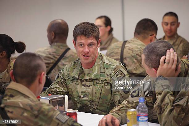 S Army SGT Noah Galloway from Birmingham Alabama speaks to soldiers during a visit to Bagram Air Field on March 12 2014 in Bagram Afghanistan...