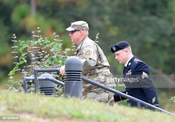 S Army Sgt Robert Bowdrie 'Bowe' Bergdahl 31 of Hailey Idaho is escorted into the Ft Bragg military courthouse for a motions hearing on October 16...