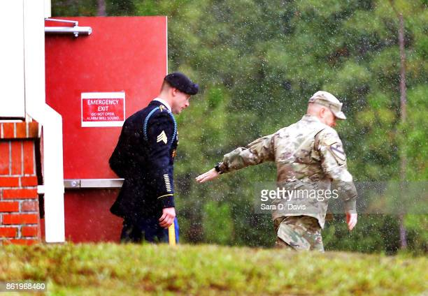 S Army Sgt Robert Bowdrie 'Bowe' Bergdahl 31 of Hailey Idaho is escorted in the driving rain from the Ft Bragg military courthouse for a lunch recess...