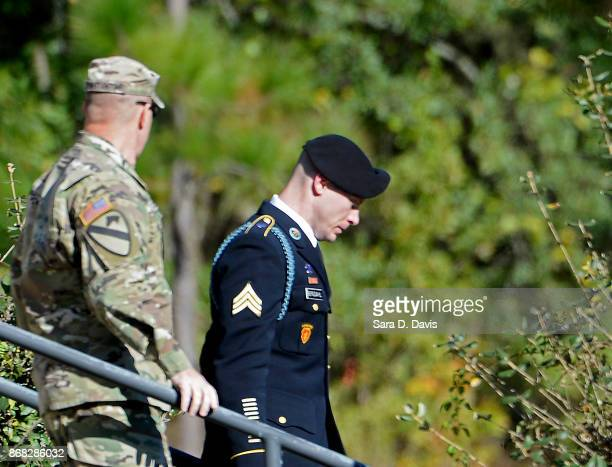 S Army Sgt Robert Bowdrie 'Bowe' Bergdahl 31 of Hailey Idaho is escorted from the Ft Bragg military courthouse after the fourth day of his sentencing...