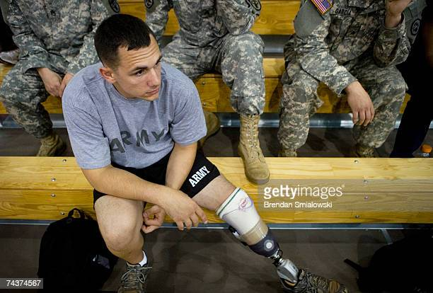 S Army Sgt Steven Curry who had part of his leg removed after losing half his foot in Iraq watches demonstrations of prosthetics at Walter Reed Army...